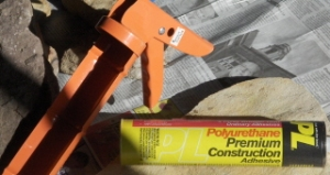 A caulking gun and polyurethane caulk for an adhesive