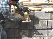 The rock is gently tapped in place, the suction holds it