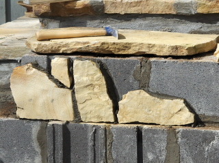 The rocks are carefully fit into place