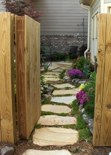 The open gate and garden pathway invited me in