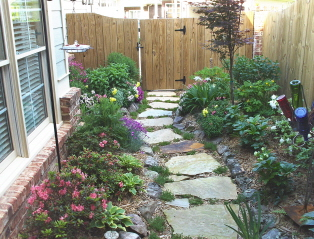 view from the patio, raised beds with perennials, natural stepping stones