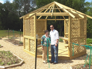 Mrs. Harbin and Mr. James are proud of the progress on the gazebo