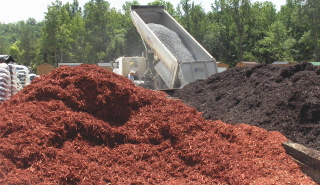 For large areas, you may purchase hardwood mulch by the truck load, picked up or delivered