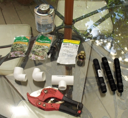 Parts and materials for building a sprinkler with pvc pipe and Rain Bird nozzles.
