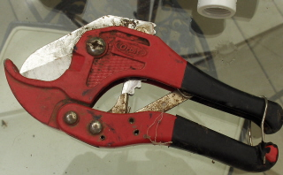 Rachet cutters are nice, a hack saw will do, or a big smile to the man at the store will also suffice, he'll do it for you.