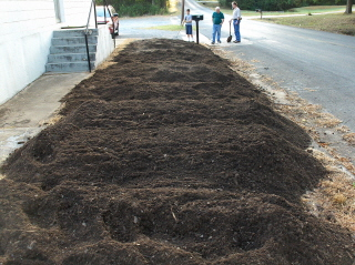 A pile of compost greeted the workers