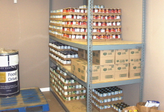 Stacks of canned food waiting for distribution