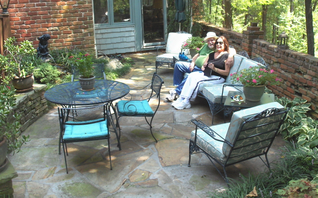 Still snuggling on the patio after all these years.  Awwww.