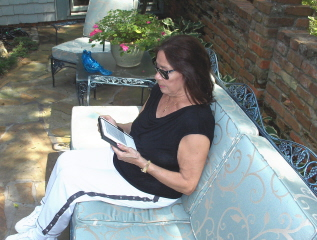 Enjoying a Kindle on a wonderful September afternoon