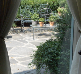 Boxwood garden and patio from a living room chair.