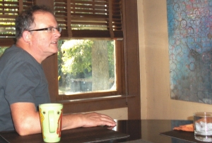 Tom Schulz, artist pontificates over morning coffee