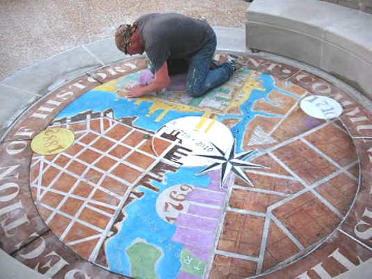 Tom Schulz finishes an installation in New Bern