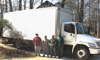 R to L, Jason and Ebie from Peachtree Junk Removal, with Santos and Victor Hugo