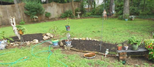 Re working a flower bed with compost and an eclectic mixed border