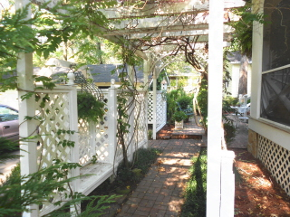 A beautiful entry arbor. Note the meditation bench to the left