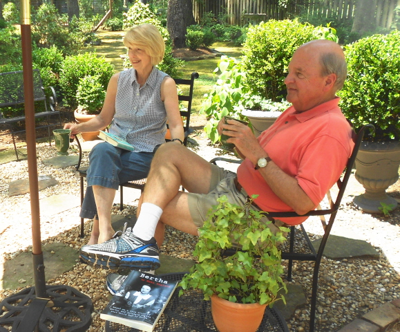 Mary and Kenneth Nance enjoy a morning cup of coffee in their lovely back yard garden.