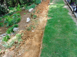 foundation dug for base of block retaining wall