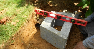 initial block in place for retaining wall. Note room for four inch cap.