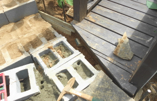 Wooden forms installed to pour concrete from the ramp to the rock step landing