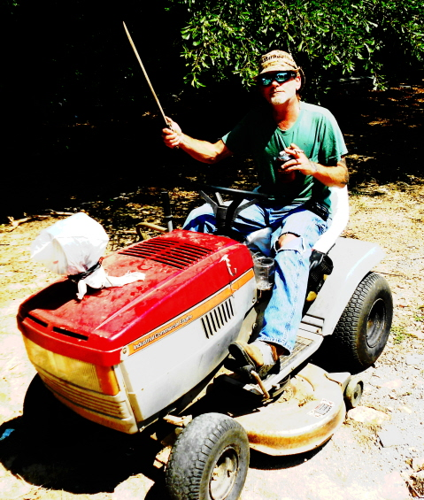 Travis loves his riding mower
