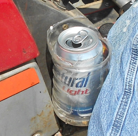 Cup holder on a riding mower