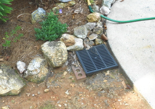 Catch basin is poorly installed and doesn't catch anything