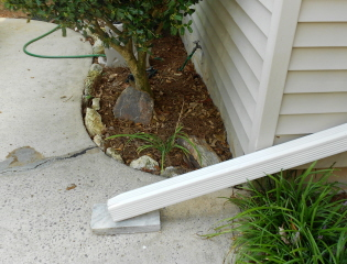 Downspout pouring water into the situation