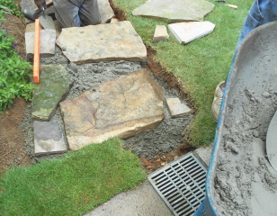 Getting started with the rock steps. We will remove the catch basin and use the steps to control water runoff.