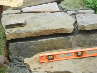 Building stone steps with a retaining wall—part two (4/6)