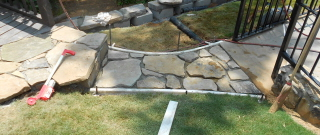 "The stones are laid for the walkway. Do you see how it ""casts"" a curve?"