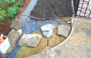 Stepping stones lead from the rock walkway to the lower garden path