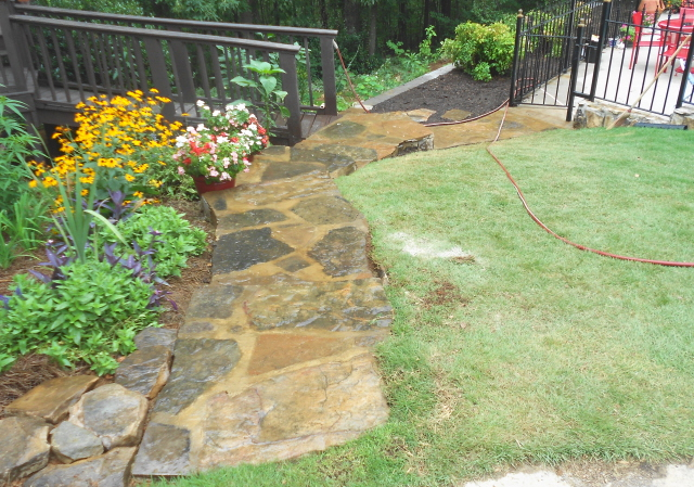 Finished rock steps to downhill pool and garden entrance
