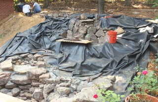 Waterfall construction with rocks and Firestone rubber liner