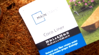 You can find coconut fiber liners for just about any wire planter