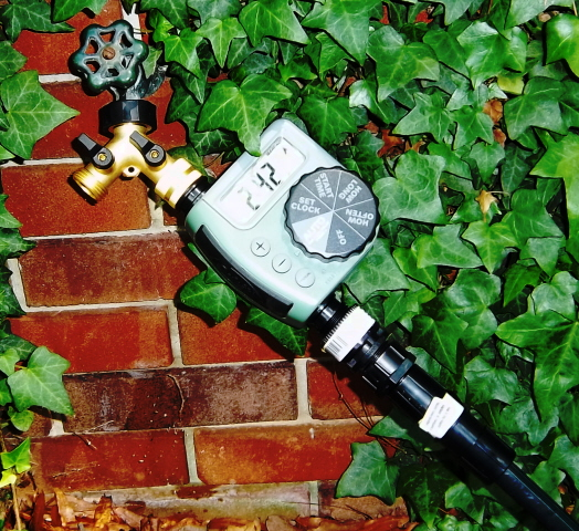 Orbit battery irrigation controller on a faucet