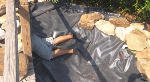Pool liner installation for a waterfall feature