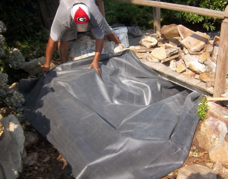 Laying out the liner for the top pool of the water feature