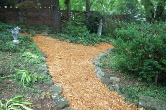 well-designed pathways add definition to a shade garden