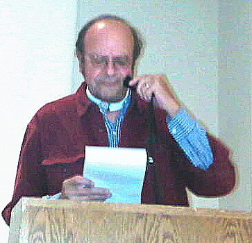 John Schulz speaking with the use of an electrolarynx