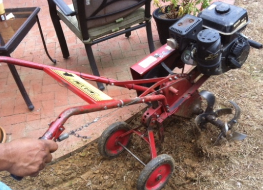 Use the tiller to lightly pulverize the top 2-3 inches of the soil