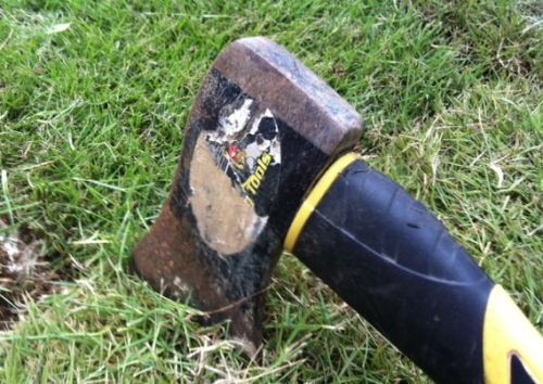 A hatchet works well to trim sod in an open area if you have a strong arm