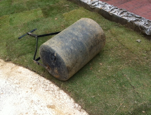 Running a water filled roller over the sod makes it smooth and nice. It also mashes the sod roots down on the ground.