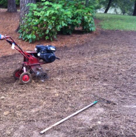 Tilling soil in preparation for planting grass seed.