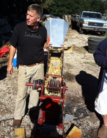 John Kenna with his hammer mill that chops up the apples.