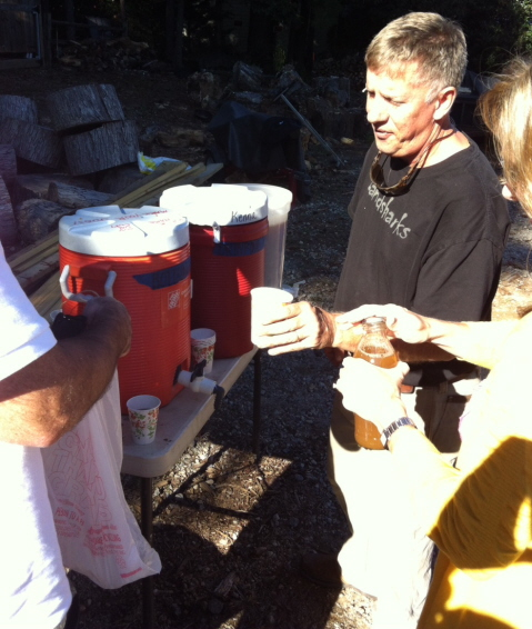 John Kenna hands out cups of cider.