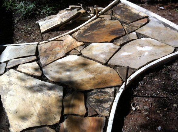 a section of flagstone laid for a patio without filled joints