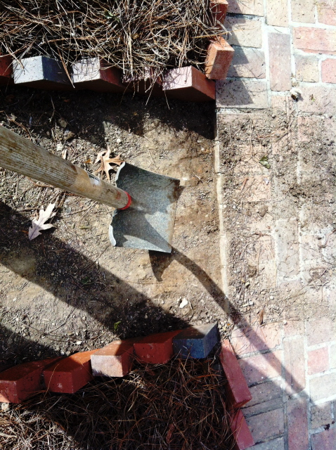 Using a flat shovel to create a border. The proper tools make a difference
