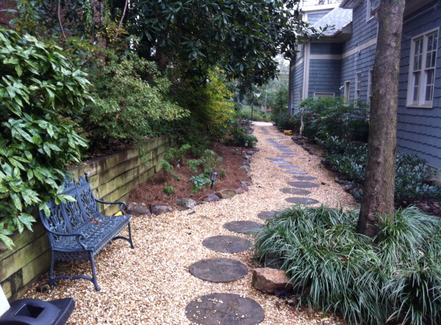 Patricia's shade garden with hand made stepping stones and pea gravel