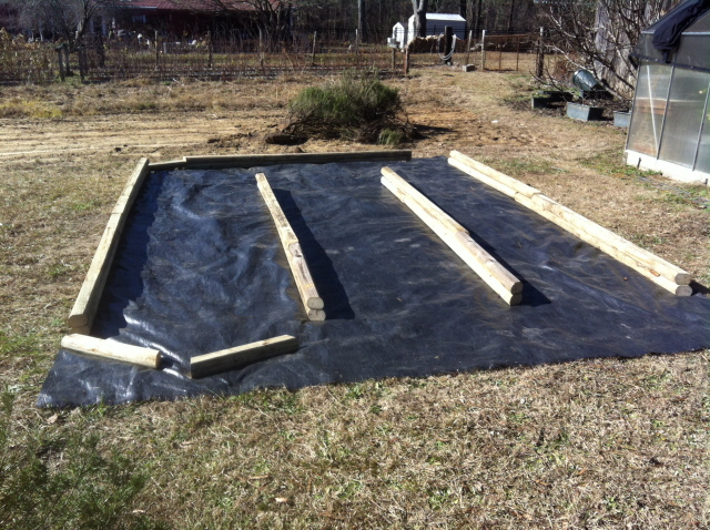 """Moving things around to get """"just the right shape"""" for the raised beds"""