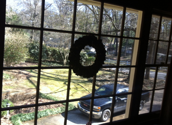 The parlor window looks out over a wonderful, well-tended back yard